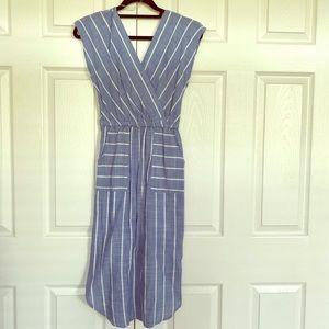 Sleeveless blue and white striped dress